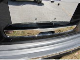 Накладка на крышку багажника под номерным знаком