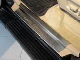 Хромированные накладки для Toyota Landcruiser Prado 120 на пороги с логотипом 4 ч. полир. нерж. сталь.